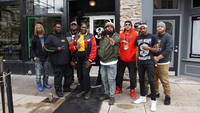 Chicago Street Idol creator Rachel Armour, fourth from left, poses with Indianapolis hip-hop artists who will perform May 24 at Bankers Life Fieldhouse.
