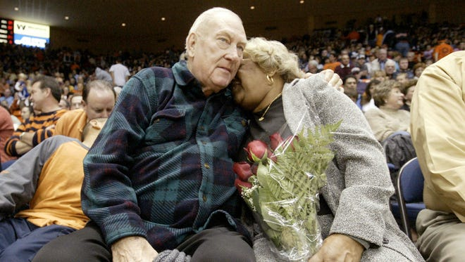 Legendary UTEP coach Don Haskins hugs Vivian Jackson, mother of Haskins' former player Jeep Jackson, during the intermission of the UTEP vs. Louisiana Tech game at the Don Haskins Center in El Paso.