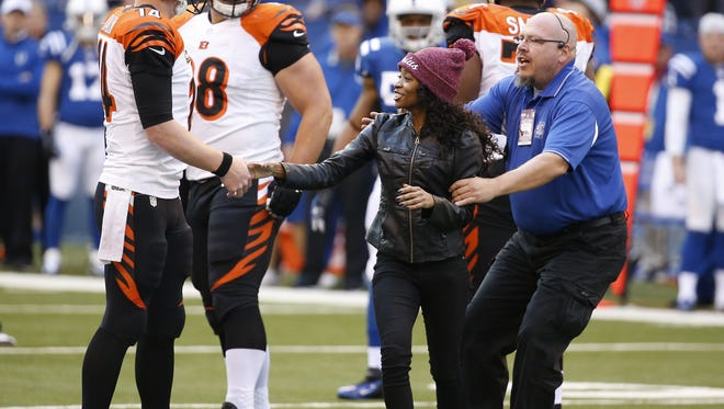 A rogue fan approached the Cincinnati Bengals quarterback Andy Dalton (14) on the final drive of the game against the Indianapolis Colts at Lucas Oil Stadium.