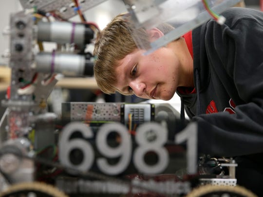 Matt Krause, a junior at Hortonville High School, works on his team's robot in preparation for the FIRST Tech Challenge World Championships next week in St. Louis.