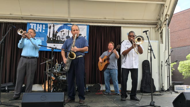 Brian Hall performing with his band during Tallahassee Music Week.