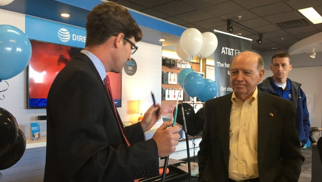 Robert Vinet, regional director with AT&T, speaks with Bossier Mayor Lo Walker (right) prior to AT&T's announcement regarding the availability of a 1 gigabit connection in Shreveport-Bossier.