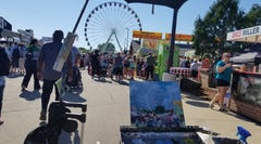 """Artist Judith Reidy painted the WonderFair Wheel in both day and night light for her entries in the Wisconsin State Fair's """"Plein Air at the Fair"""" contest."""
