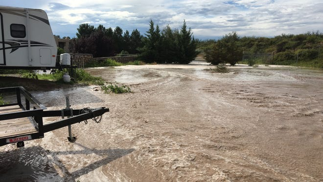 Heavy stormwater covers a neighborhood off El Camino Real Road north of Las Cruces in August 2017. Small businesses in New Mexico are urged to plan ahead for how they'd respond to a natural disaster, like flooding, if it strikes in their area.