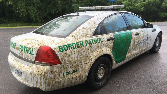 This Aug. 3, 2017 photo provided by U.S. Customs and Border Protection shows a U.S. Border Patrol car that had been sprayed with manure in Alburgh, Vt. Mark Johnson, 53, of Alburgh, is charged with spraying liquid manure on a marked U.S. Customs and Border Protection car after confronting an agent about immigration enforcement.