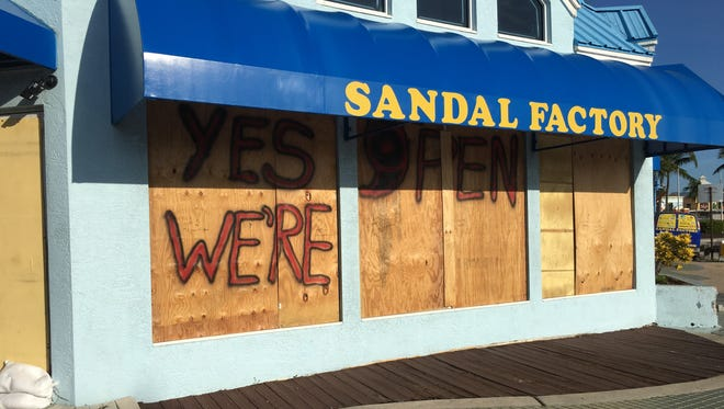 The Sandal Factory on Fort Myers Beach was boarded up by Friday morning with plywood that appeared to have been used for Hurricane Wilma in 2005.