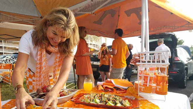 Alison Turner of Nashville arranges tailgating snacks before the Tennessee vs. South Carolina football game on Saturday, Oct. 14, 2017.