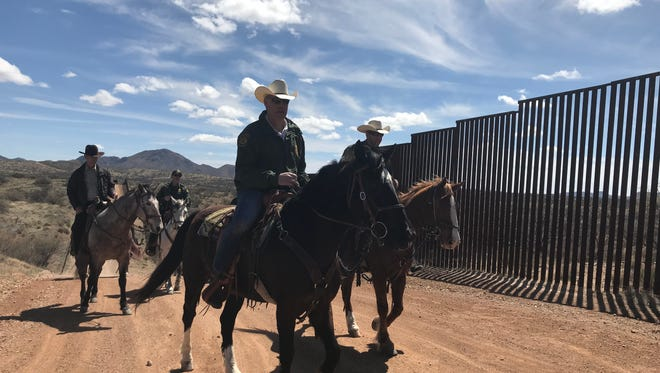 Interior Secretary Ryan Zinke toured the U.S.-Mexico border on horseback with Border Patrol agents at the Buenos Aires National Wildlife Refuge, which his department manages, on March 17, 2018.