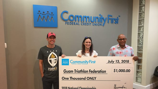 Community First Guam Federal Credit Union recently donated $1,000 to the Guam Triathlon Federation to support the 2018 Guam National Triathlon Championships on July 15. Pictured from left: Cameron O'Neal and Karly O'Neal of Guam Triathlon Federation, and Gerard A. Cruz, president and CEO of Community First.