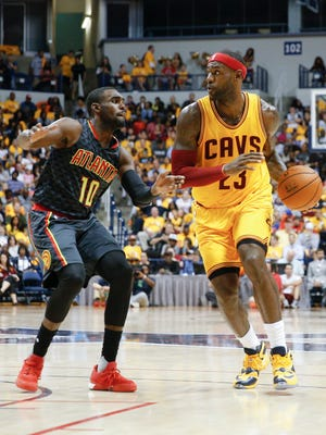 Tim Hardaway Jr. checks LeBron James in a preseason game earlier this month.