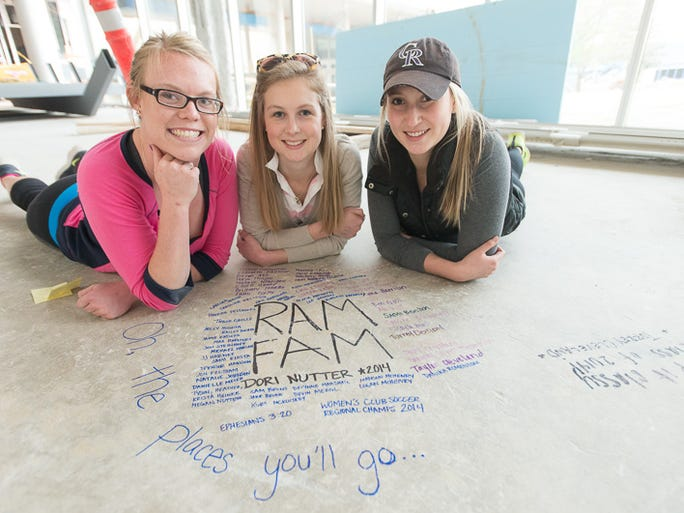 CSU Seniors sign the floor in the Sunken Lounge of the Lory Student Center, May 6, 2014