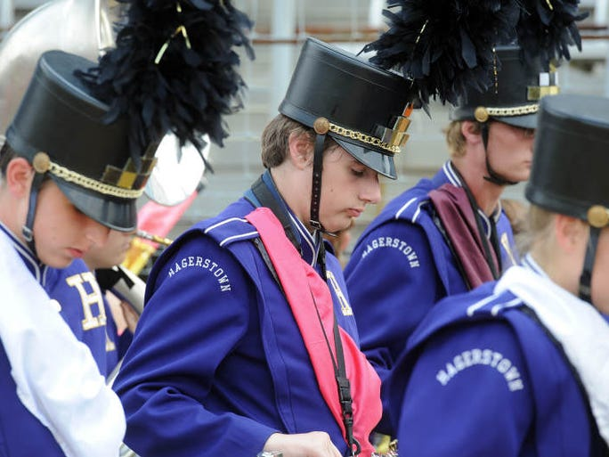 Hagerstown High School band and colorguard members prepare for their performance at Indiana State Fair Band Day Saturday, Aug. 2, 2014.