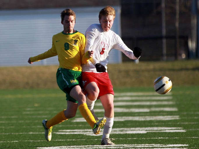 City High's Collin O'Meara collides into Cedar Rapids Kennedy's Reid Botkin during their game on Tuesday, April 15, 2014.