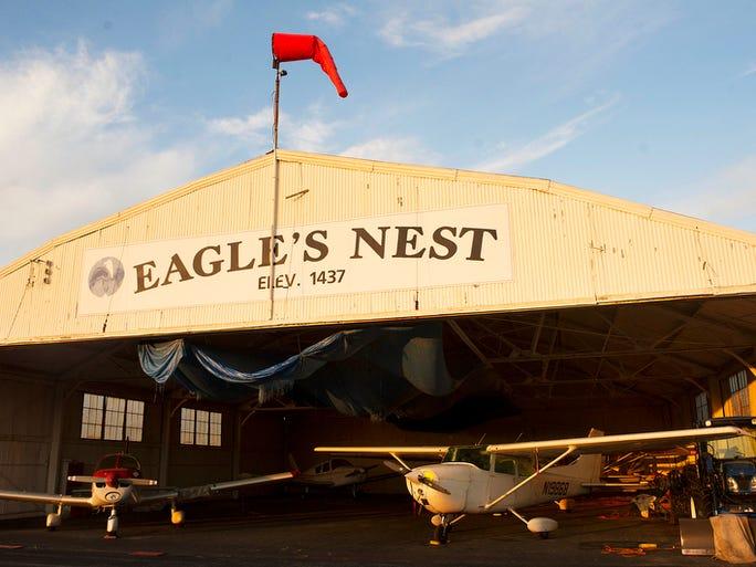 The sun rises on the main maintenance hangar on April 7, 2013, at Eagle's Nest Airport in Waynesboro.