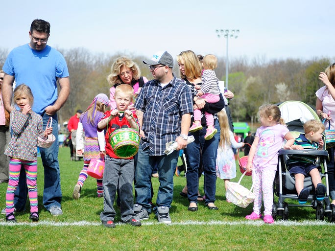 Kids line up to hunt for eggs in the 4 and 5-year old division during the Eggstavaganza Egg Hunt on Saturday, April 19, 2014, at Montgomery Hall Park in Staunton.