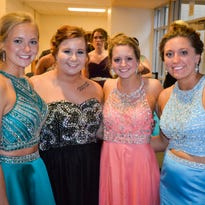 Alexa Ruehle, Hedy Robben, Kaitlyn Truenow, and Becky Holtz pose for a group photo at Kimball High School Prom April 30th, 2016.