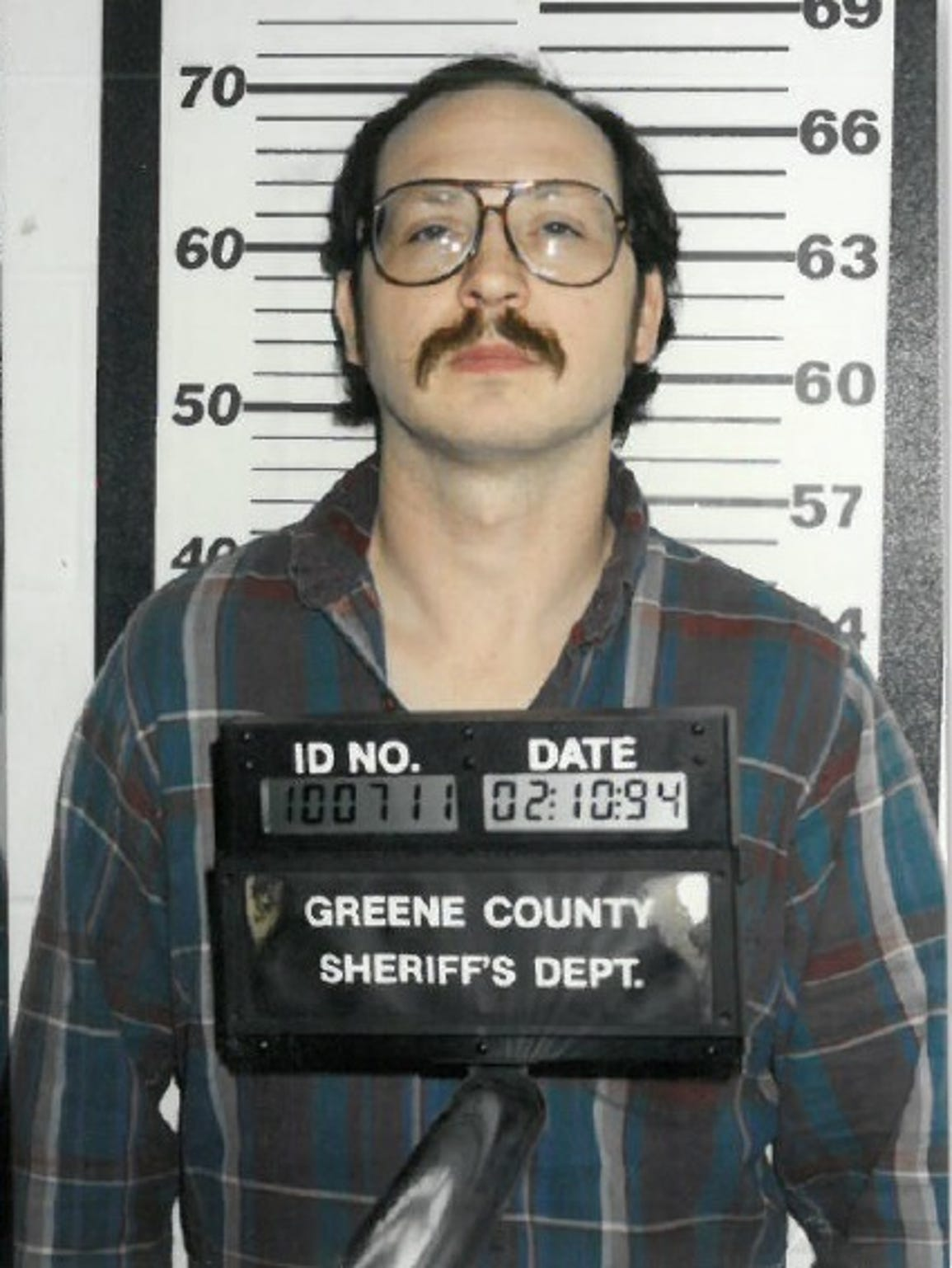 A 1994 booking photo of Mike Poplawski