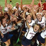 "Players celebrate after the Sacred Heart Academy varsity field hockey team defeated the Assumption High School varsity team 2-0 in the ""Stick it to Cancer"" 2015 Apple Tournament on the SHA campus home field Friday night. Over $8000 was raised for the J. Graham Brown Cancer Center. August 28. 2015."
