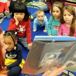 Youth Services Librarian Deborah White reads to children during Story Time at Oak Grove Library.