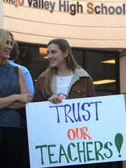 CVUSD board meeting 4  Gina Muscatel, left, and her daughter, Quinn Muscatel, hold a sign outside the Conejo Valley Unified School District office before Tuesday night's board meeting.