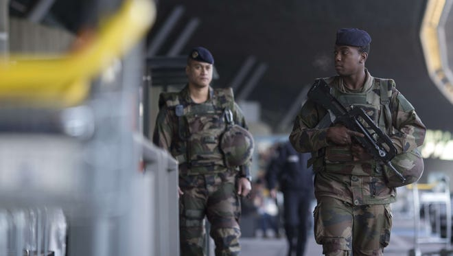 French soldiers patrol a terminal of the Charles-de-Gaulle Airport in Paris on Jan. 17.