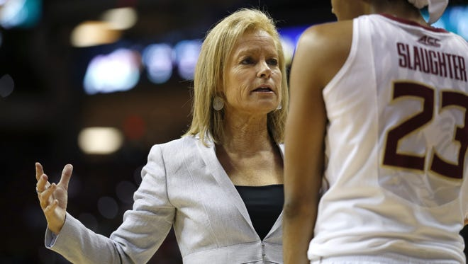 Head Coach Sue Semrau talks to Ivey Slaughter during their game against ASU in round one of the NCAA Tournament at the Civic Center on Saturday.