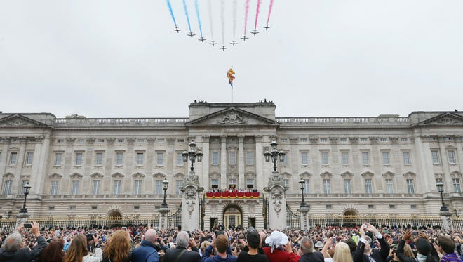 The Red Arrows aerobatic display team makes a flypast during the Trooping the Color parade to mark the Queen's official birthday at Buckingham Palace, in London, Saturday, June 13, 2015.