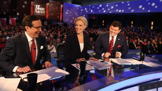 Moderators Bret Baier, Megyn Kelly and Chris Wallace at the Fox News Channel Republican presidential primary  debate with Ohio Gov. John Kasich, former Florida Gov. Jeb Bush, Florida Sen. Marco Rubio, Texas Sen. Ted Cruz, retired neurosurgeon Ben Carson, New Jersey Gov. Chris Christie and Kentucky Sen. Rand Paul at the Iowa Events Center in Des Moines, Iowa, Thursday Jan. 28, 2016.