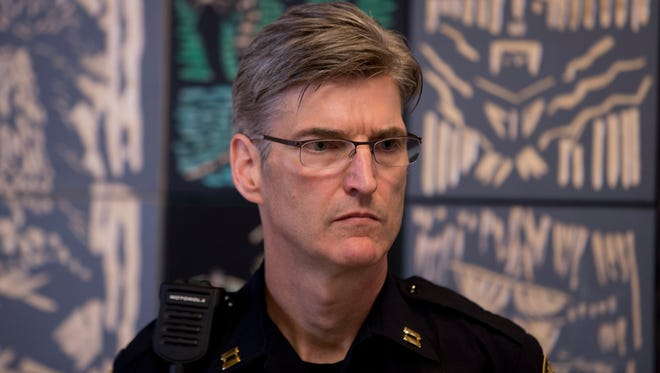 Capt. Mike Marshman listens as Portland Mayor Charlie Hales announces the anticipated shakeup in the top command staff of the Police Bureau.