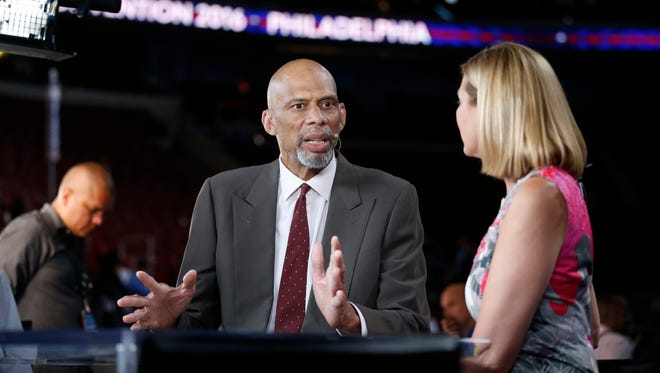 NBA former player Kareem Abdul-Jabbar conducts a television interview before the start of the 2016 Democratic National Convention at Wells Fargo Arena.