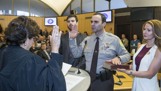 Judge Mary Murguia swears in Paul Penzone as the new Maricopa County sheriff. Next to Penzone is his wife, Veronica, and son, Austin, in Phoenix on Jan. 4, 2017.