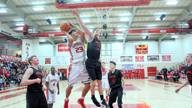 Artesia's Caleb Dean attempts to block a shot by Roswell's Chris Mesquita on Tuesday.