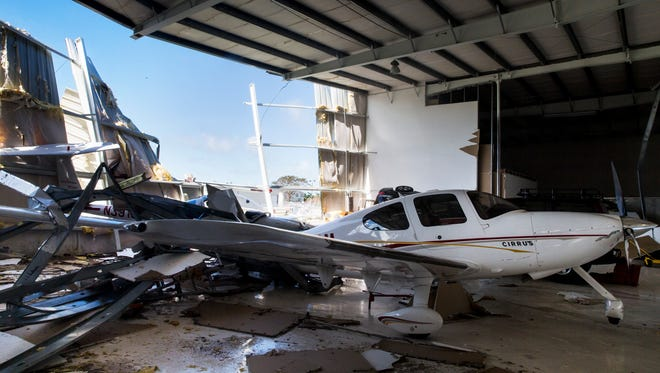 A plane sits in a hanger damaged by Hurricane Irma at the Naples Municipal Airport on Tuesday, Sept. 12, 2017.