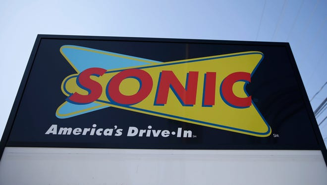 """This Monday, March 9, 2015, file photo shows a sign for a Sonic Drive-In in Holmes, Pa. Sonic says there's been some """"unusual activity"""" on credit cards used at some of its drive-in restaurants. The chain said that it is working with third-party forensic experts and law enforcement officials on the incident."""