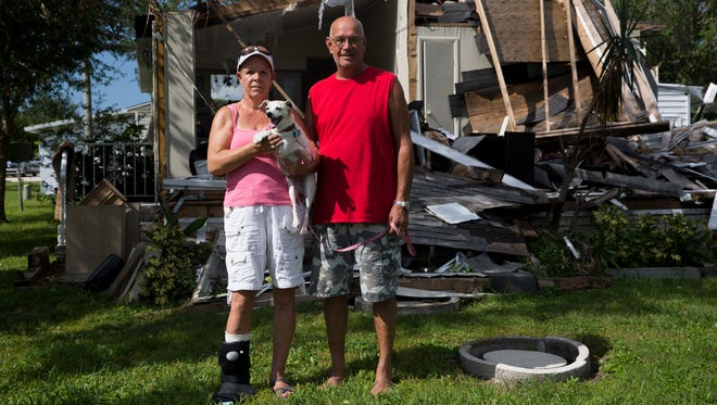 """Mike and Judy Erickson's home in Riverwood Estates, a 55-and-over community along Collier Boulevard South, was completely destroyed during Hurricane Irma just over one month ago. The couple's request for funding through FEMA is pending. """"The inspection to your property is pending because the area where your property is located is inaccessible,"""" Judy Erickson cites from the FEMA mobile app. """"Because a housing inspector won't come out they won't approve our request for housing. We're just stuck. I've done everything I can."""" Monday, Oct. 16, 2017, in East Naples."""