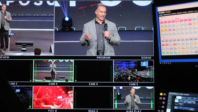 Pastor Ron Carpenter, as seen from the control booth of his Redemption Church, announces that he will be stepping down in the coming months to take over another ministry in California.