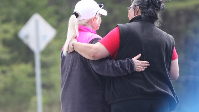 At the Union Hill Church Saturday, friends and family gathered in the wake of the execution style killings that claimed the lives of eight members of the Rhoden family.