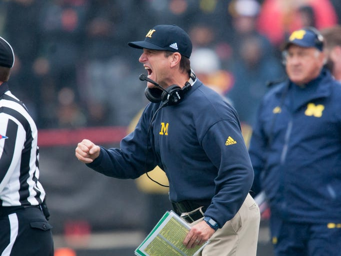 Michigan head coach Jim Harbaugh celebrates after Michigan