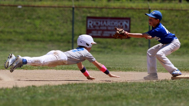 Anthony Bottomley slides back into second after realizing he could not make it to third in the Shrine Tournament semifinal game against MedBen. LMH took the win, 21-6.