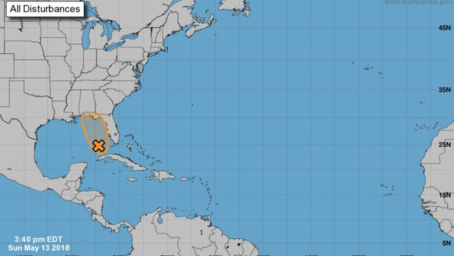 The National Hurricane Center gives a look at the path of a potentially tropical system stalled over the Gulf of Mexico on May 14, 2018.