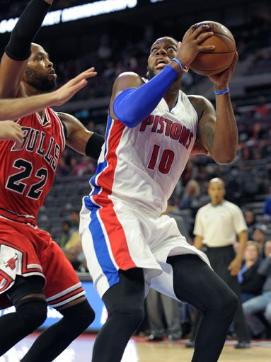 Detroit's Greg Monroe shoots over the Bulls' Taj Gibson
