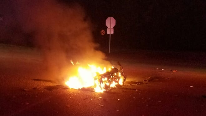 A motorcycle caught fire after being struck by a pickup early Monday morning. The motorcyclist was thrown from the bike and suffered severe injuries.