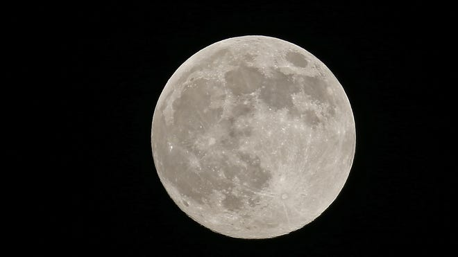 A supermoon is the coincidence of a full moon or a new moon with the closest approach the Moon makes to the Earth on its elliptical orbit, resulting in the largest apparent size of the moon's disk as seen from Earth.