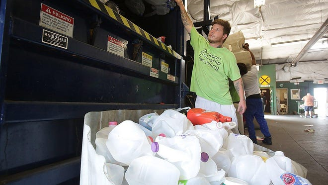 Chris Ballog, assistant manager at the Jackson Township  Recycling Center, prepares to add a load of plastics to be crushed at the station 5717 Wales Ave. NW.