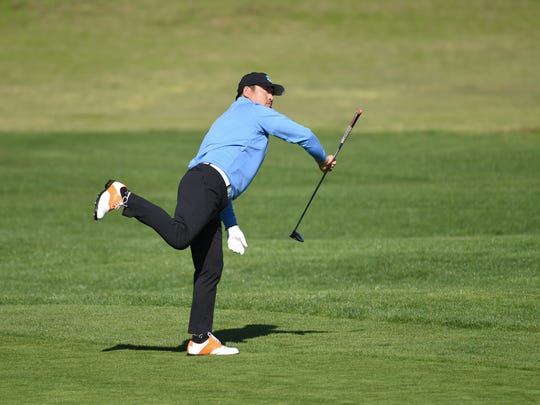 Feb 9, 2019; Pebble Beach, CA, USA; Ho-sung Choi follows through on his fairway shot on the second hole during the third round of the AT&T Pebble Beach Pro-Am golf tournament at Pebble Beach Golf Links. Mandatory Credit: Michael Madrid-USA TODAY Sports
