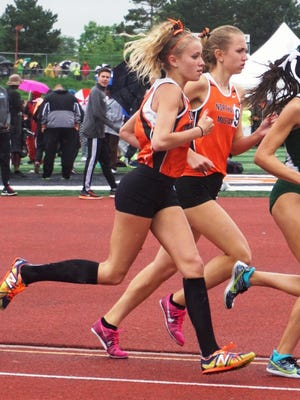 Northville's Lexa Barrott (middle) and Cayla Eckenroth (left) finished third and sixth, respectively, in the 3,200-meter run at the girls track and field state finals.