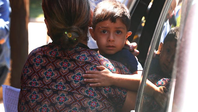 A child from Honduras is brought to the United States Immigration and Customs Enforcement office in Grand Rapids, Mich., Tuesday, July 10, 2018. Two boys and a girl who had been in temporary foster care in Grand Rapids have been reunited with their Honduran fathers after they were separated at the U.S.-Mexico border about three months ago.