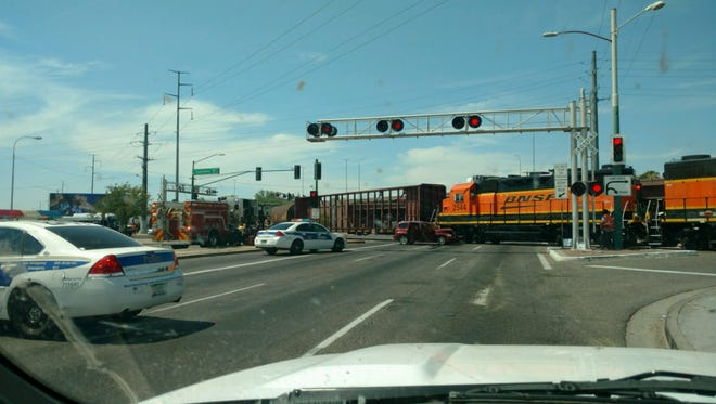 A car and train collided near 43rd Avenue and Camelback Road/Grand Avenue in Phoenix on July 11, 2017.