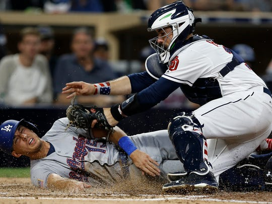 San Diego Padres catcher Austin Hedges, right, tags out Los Angeles Dodgers' Austin Barnes during the fourth inning of a baseball game in San Diego, Saturday, July 1, 2017.