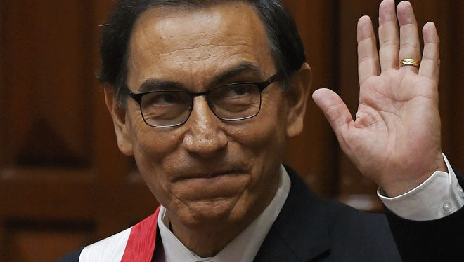 Peru's new President Martin Vizcarra waves after being invested during a ceremony at the Congress in Lima on March 23, 2018.
